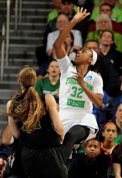 Notre Dame guard Jewell Loyd puts up a shot in the first half of their NCAA women's college basketball tournament regional final game at the Purcell Pavilion in South Bend, Ind Monday March 31, 2014. (AP Photo/Joe Raymond)