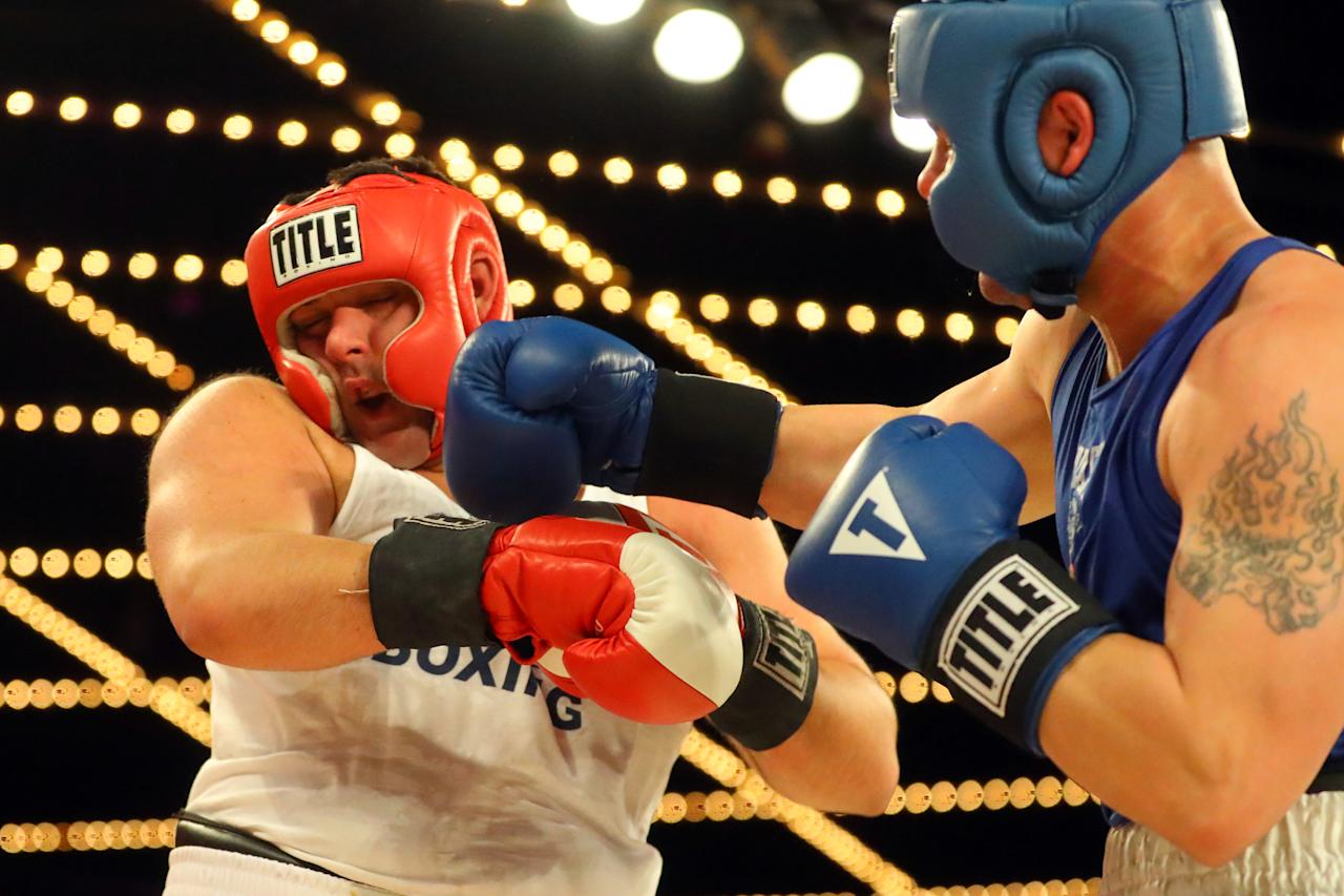 <p>Jerry Packtor (red) gets a right to the jaw from Mark Sinatra (blue) in Super Heavyweight action during the NYPD Boxing Championships at the Hulu Theater at Madison Square Garden on March 15, 2018. (Gordon Donovan/Yahoo News) </p>