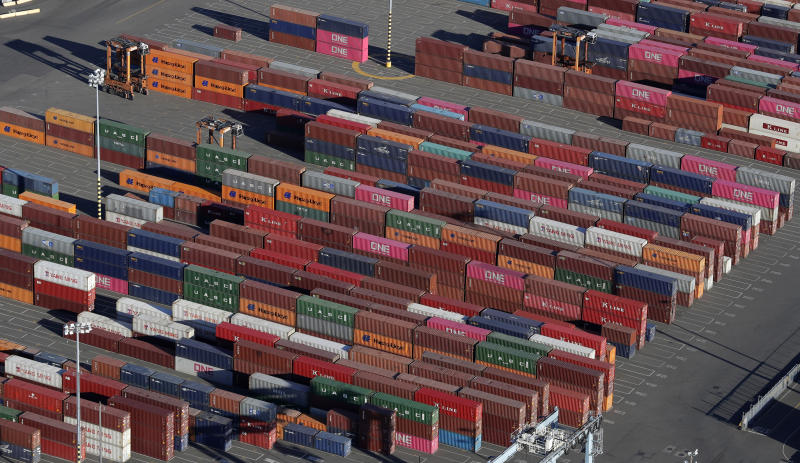 FILE - In this March 5, 2019, file photo, cargo containers are staged near cranes at the Port of Tacoma, in Tacoma, Wash. Some are moving factories out of China. Others are strategically redesigning products. Some are seeking loopholes in trade law or even mislabeling where their goods originate, all with the goal of evading President Donald Trump's sweeping tariffs on goods from China. (AP Photo/Ted S. Warren, File)