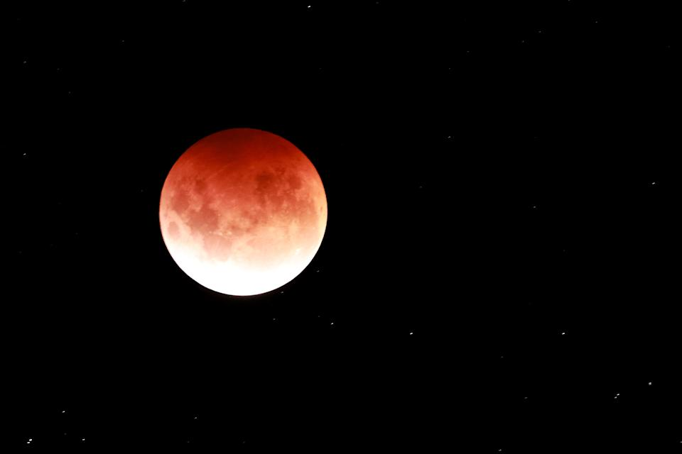 AUCKLAND, NEW ZEALAND - MAY 26: The Total Lunar Eclipse of the Moon is seen on May 26, 2021 in Auckland, New Zealand. It is the first total lunar eclipse in more than two years, which coincides with a supermoon.  A super moon is a name given to a full (or new) moon that occurs when the moon is in perigee - or closest to the earth - and it is the moon's proximity to earth that results in its brighter and bigger appearance. (Photo by Phil Walter/Getty Images)