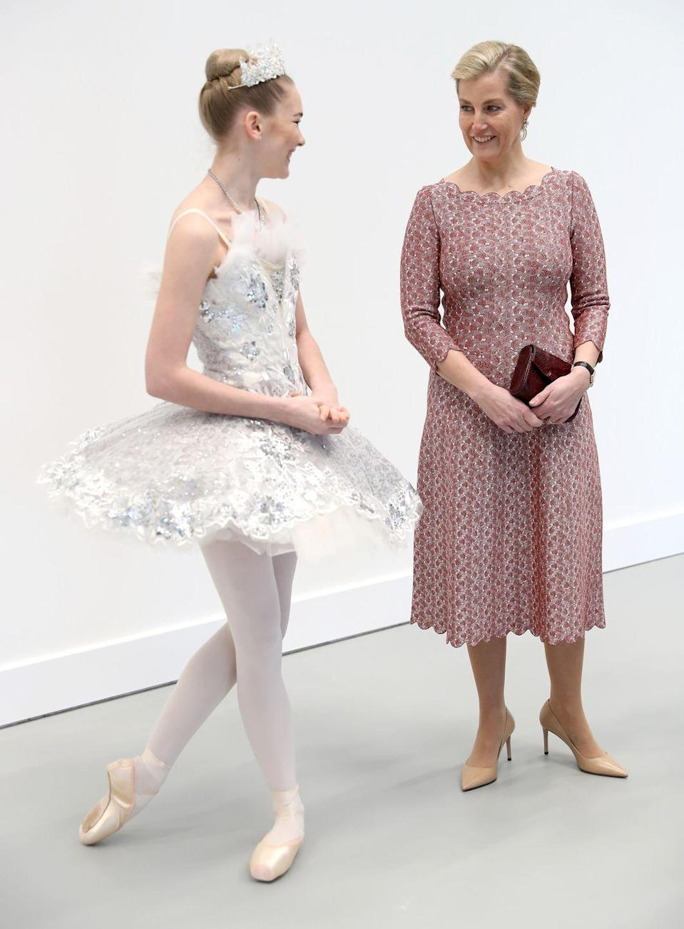 <p>In London, the Countess stunned in a red and white lace-patterned dress with a scalloped neckline. She wore this elegant look to open the Countess of Wessex Studios at the Central School of Ballet's new location, pairing the dress with a ballerina-inspired updo. </p>