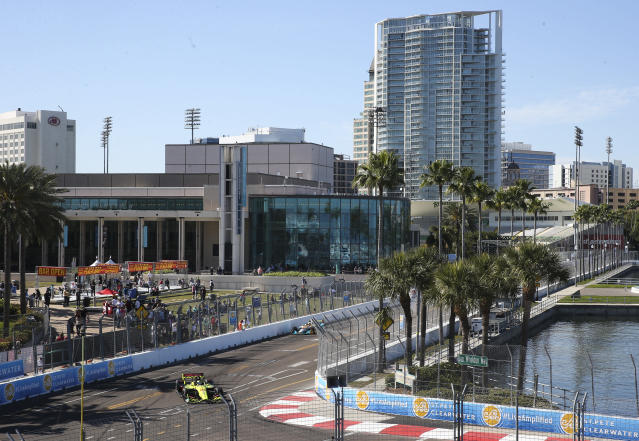 With the Mahaffey Theater and the city in the background, IndyCar driver Sebastien Bourdais makes his way through Turn 10 during practice for the IndyCar Grand Prix of St. Petersburg auto race, Friday, March 9, 2018, in St. Petersburg, Fla. (Dirk Shadd/The Tampa Bay Times via AP)
