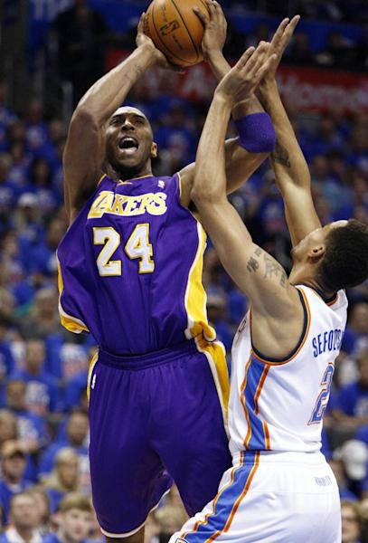 Los Angeles Lakers' Kobe Bryant (24) shoots against Oklahoma City Thunder guard Thabo Sefolosha (2) during the first quarter of Game 5 in their NBA basketball Western Conference semifinal playoff series, Monday, May 21, 2012, in Oklahoma City. (AP Photo/Alonzo Adams)