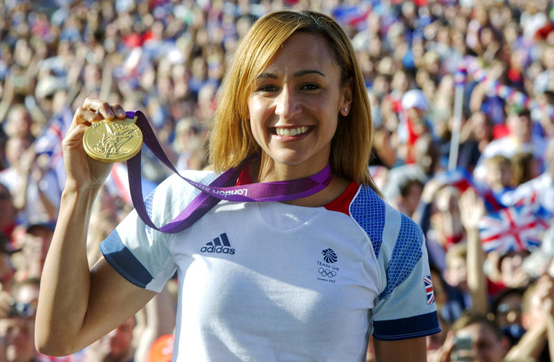 British track and field athlete Jessica Ennis holds up her heptathlon gold medal while greeting fans at the BT London Live concert at Hyde Park in central London during the 2012 Summer Olympics,  Sunday, Aug 5, 2012. (AP Photo/Joel Ryan)