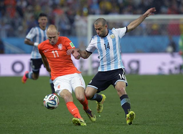 Netherlands' Arjen Robben, left, is challenged by Argentina's Javier Mascherano during the World Cup semifinal soccer match between the Netherlands and Argentina at the Itaquerao Stadium in Sao Paulo Brazil, Wednesday, July 9, 2014. (AP Photo/Manu Fernandez)