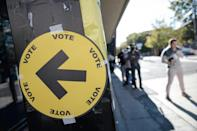 People line up at a Montreal polling station to vote in hotly-contested Canadian snap elections (AFP/Andrej Ivanov)