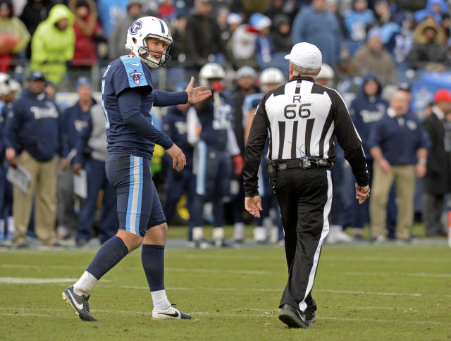 Tennessee Titans punter Brett Kern argues his case with referee Walt Anderson in the second half of Sunday's game against the Los Angeles Rams. Anderson's crew made a second-half mistake that negated a successful onside kick for Tennessee. (AP)