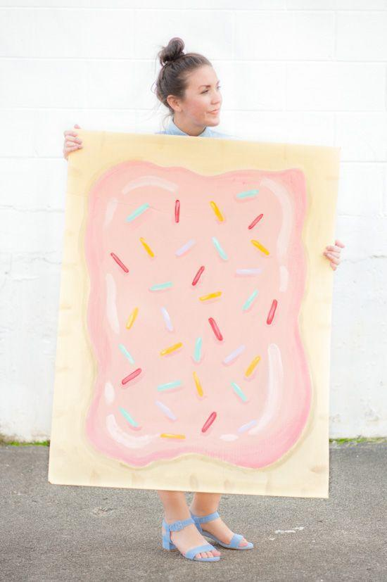"""<p>Talk about a real trick-or-<em>treat</em>: It doesn't get much better (or more nostalgic) than a massive Pop Tart. Bonus points if you bring along a box of the real deal as a prop (or turn it into a purse!). </p><p><strong>Get the tutorial at <a href=""""https://www.papernstitchblog.com/5-costume-idea-diy-pop-tart-costume-for-halloween/"""" rel=""""nofollow noopener"""" target=""""_blank"""" data-ylk=""""slk:Paper & Stitch"""" class=""""link rapid-noclick-resp"""">Paper & Stitch</a>.</strong></p><p><strong><a class=""""link rapid-noclick-resp"""" href=""""https://www.amazon.com/Bates-Paint-Brushes-Professional-Paintbrush/dp/B07FW83JCJ/?tag=syn-yahoo-20&ascsubtag=%5Bartid%7C10050.g.21600836%5Bsrc%7Cyahoo-us"""" rel=""""nofollow noopener"""" target=""""_blank"""" data-ylk=""""slk:SHOP PAINT BRUSHES"""">SHOP PAINT BRUSHES</a><br></strong></p>"""