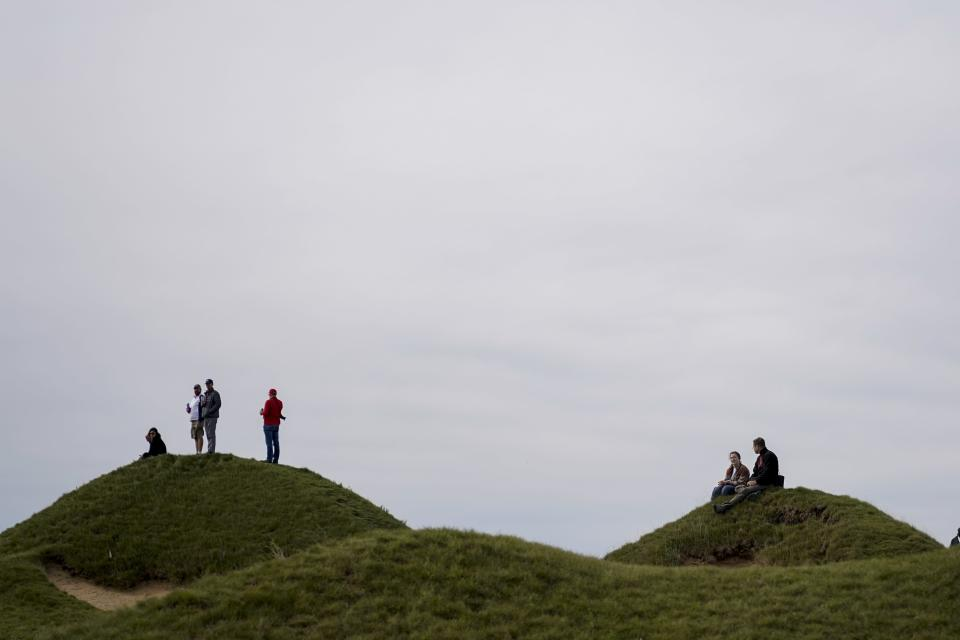 Fans watch from the fourth hole during a practice day at the Ryder Cup at the Whistling Straits Golf Course Wednesday, Sept. 22, 2021, in Sheboygan, Wis. (AP Photo/Ashley Landis)