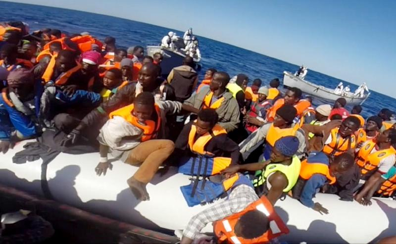Video grab released by the Italian Coast Guard (Guardia Costiera) on May 2, 2015 shows some of 220 shipwrecked migrants being rescued by the Italian coast guard, on May 1, 2015, in the Mediterranean Sea, off the coast of Sicily (AFP Photo/)