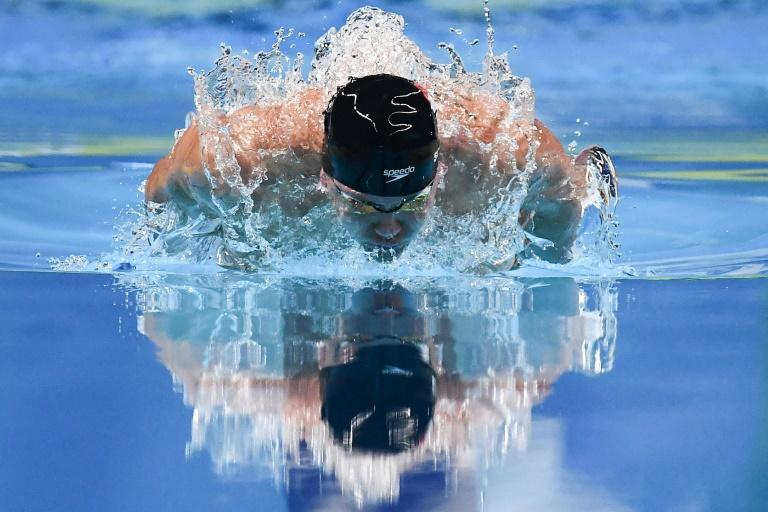 Singapore's Joseph Schooling successfully defended his 100m butterfly title