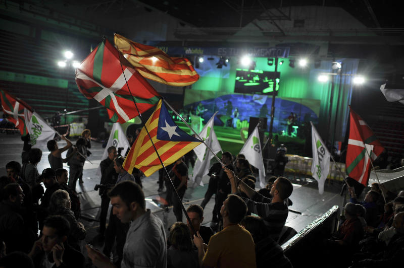Supporters of Euskal Herria Bildu, the new pro independence Basque Party, wave Basque flags and Catalunya flags, after parliamentary elections to the next Basque Parliament, in Bilbao, northern Spain, Sunday Oct. 21, 2012. Almost 4.5 million people will go to the polls Sunday in regional elections in Spain's turbulent Basque region and in northwestern Galicia.(AP Photo/Alvaro Barrientos)