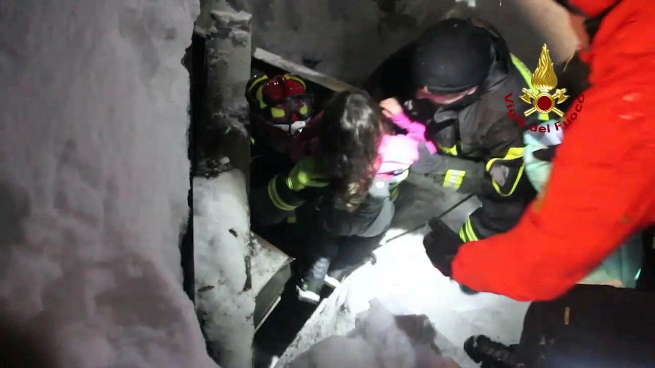 A still image taken from a video shows a survivor, rescued by Italian Firefighters, at the Hotel Rigopiano in Farindola, central Italy, which was hit by an avalanche, in this January 21, 2017 handout provided by Italy's Firefighters. Vigili del Fuoco/Handout via REUTERS ATTENTION EDITORS - THIS IMAGE WAS PROVIDED BY A THIRD PARTY. EDITORIAL USE ONLY.     TPX IMAGES OF THE DAY