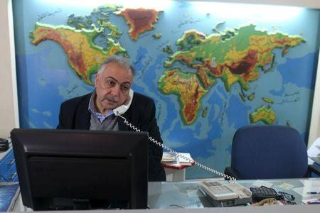 Palestinian travel agent Nabil Shurafa speaks on a phone at his office in Gaza City