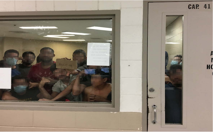 Eighty-eight men crowd into a cell with a maximum capacity of 41 on June 12 at the Border Patrol's Fort Brown Station. Some of the men signal their prolonged detention to OIG staff.
