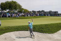 Russell Henley reacts after making his birdie shot from the bunker on the 11th green during the third round of the U.S. Open Golf Championship, Saturday, June 19, 2021, at Torrey Pines Golf Course in San Diego. (AP Photo/Jae C. Hong)