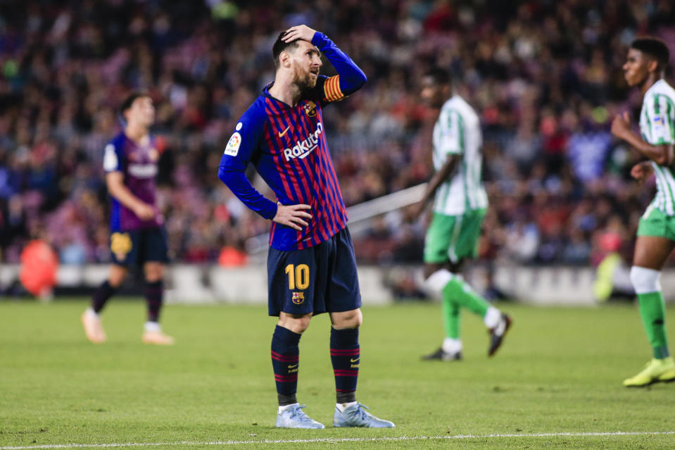 Lionel Messi scored twice and had an assist but Barcelona's poor defending cost them in a 4-3 loss to Real Betis at Camp Nou. (Xavier Bonilla/Getty Images)