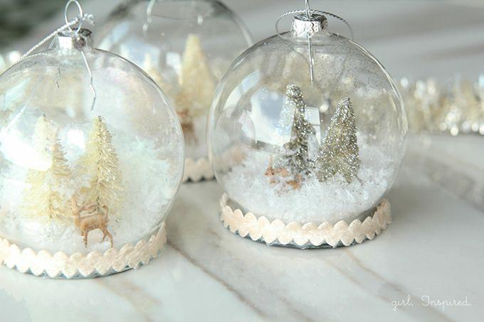 """<p>Snatch up a bunch of clear plastic ornaments from your local craft store, then fill them with animal figures, mini trees, and faux snow. </p><p><strong>Get the tutorial at <a href=""""http://thegirlinspired.com/2014/12/diy-snow-globe-ornaments/#_a5y_p=3070831"""" rel=""""nofollow noopener"""" target=""""_blank"""" data-ylk=""""slk:The Girl Inspired"""" class=""""link rapid-noclick-resp"""">The Girl Inspired</a>.</strong></p><p><a class=""""link rapid-noclick-resp"""" href=""""https://www.amazon.com/Buffalo-Flurries-Extra-Quart-Measure/dp/B00113XD54/ref=dp_fod_2?pd_rd_i=B00113XD54&psc=1&tag=syn-yahoo-20&ascsubtag=%5Bartid%7C10050.g.2832%5Bsrc%7Cyahoo-us"""" rel=""""nofollow noopener"""" target=""""_blank"""" data-ylk=""""slk:SHOP SNOWFLAKES"""">SHOP SNOWFLAKES</a></p>"""