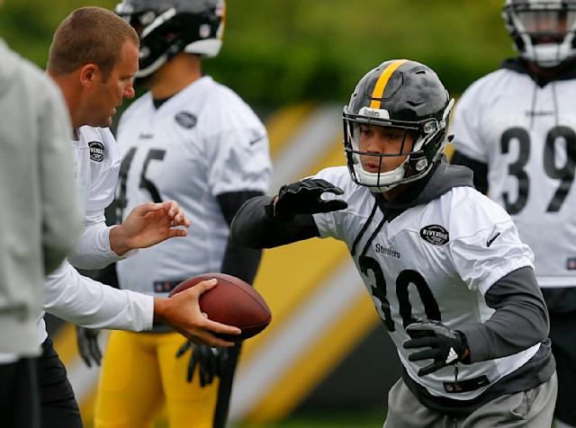 James Conner has seen pressure on and off the field in his life and says he's not fazed by the spotlight thrust upon him in Le'Veon Bell's absence. (AP)