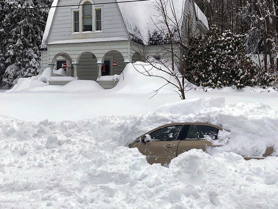 CORRECTS CITY TO OWEGO, N.Y. This photo, provided by the New York State Police, shows a car, in Owego, NY, from which a New York State Police sergeant rescued Kevin Kresen, 58, of Candor, NY, stranded for 10 hours, covered by nearly 4 feet of snow thrown by a plow during this week's storm. Authorities say the New York State Police sergeant rescued Kresen stranded for hours in a car covered by nearly 4 feet of snow thrown by a plow during this week's storm. The 58-year-old Candor man drove off the road and got plowed in by a truck. (New York State Police via AP)