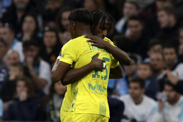 Nantes' Anthony Limbombe celebrates with teammate after he scored his side's opening goal during the French League One soccer match between Marseille and Nantes at the Stade Velodrome in Marseille, southern France, Sunday Feb. 22, 2020. (AP Photo/Daniel Cole)
