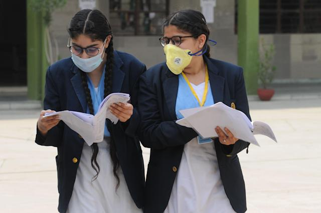 Students wear face mask to protect themselves from infection, in wake of the coronavirus (COVID-19) outbreak in Jalandhar.