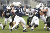 Penn State quarterback Sean Clifford (14) throws a touchdown pass to wide receiver Parker Washington (3) during the third quarter of an NCAA college football game in State College, Pa., on Saturday, Dec. 12, 2020. Penn State defeated Michigan State 39-24. (AP Photo/Barry Reeger)