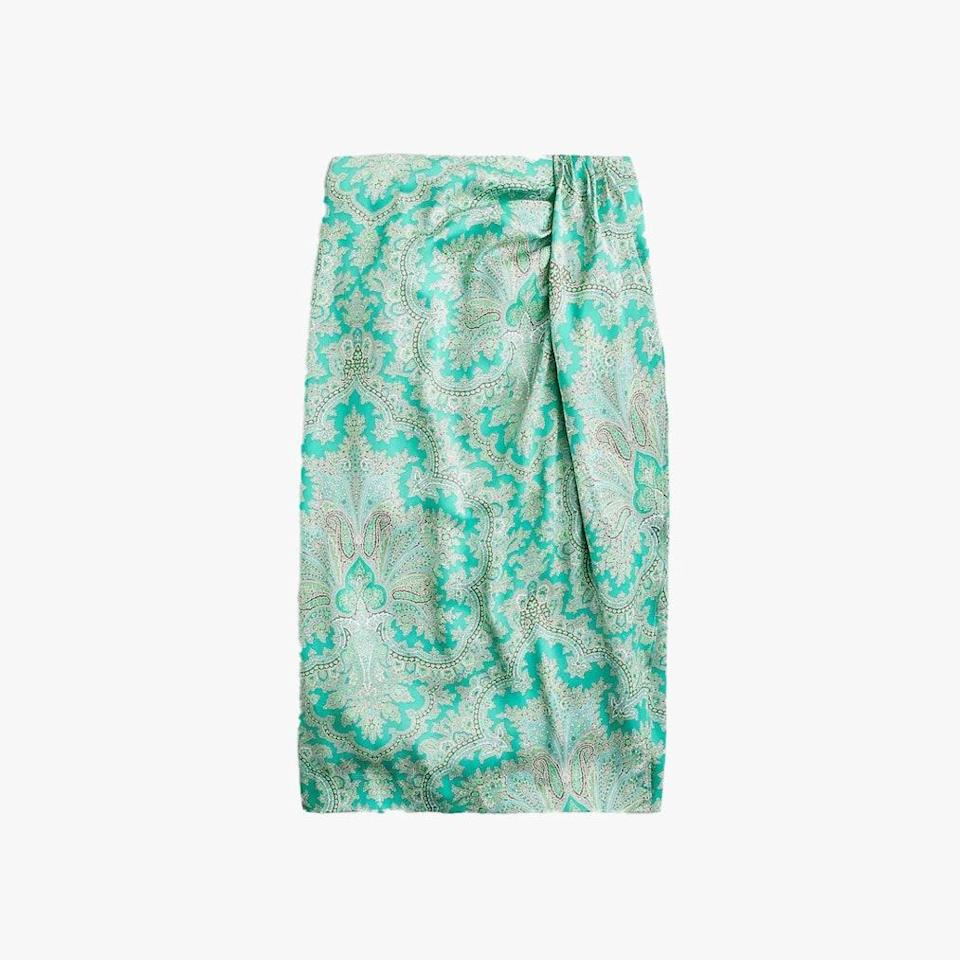 """$148, J.CREW. <a href=""""https://www.jcrew.com/us/p/womens_category/skirts/midi/sarong-skirt-in-ratti-pendant-paisley/AW492"""" rel=""""nofollow noopener"""" target=""""_blank"""" data-ylk=""""slk:Get it now!"""" class=""""link rapid-noclick-resp"""">Get it now!</a>"""