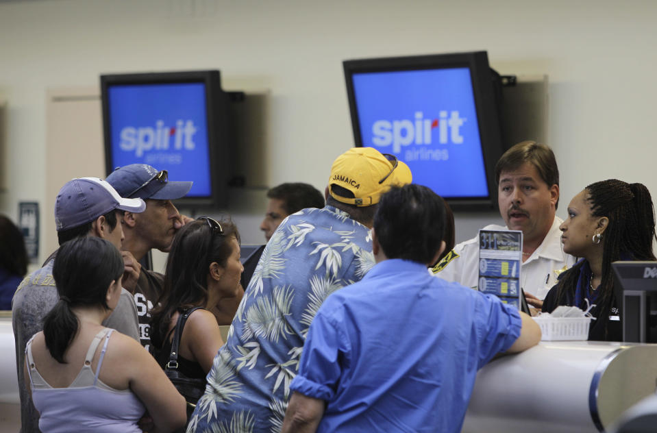 Stranded passengers complain at the Fort Lauderdale-Hollywood International Airport in Fort Lauderdale, Florida. (AP Photo/Lynne Sladky)