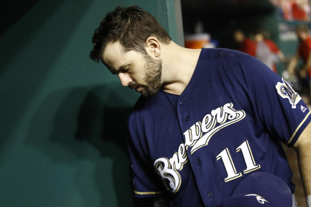 Milwaukee Brewers' Mike Moustakas walks out of the dugoutafter a National League wild-card baseball game against the Washington Nationals, Tuesday, Oct. 1, 2019, in Washington. Washington won 4-3. (AP Photo/Patrick Semansky)