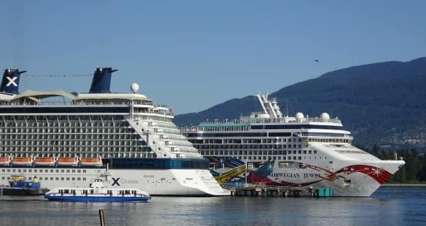 Cruise ships are pictured in Vancouver in May 2016. Ships will be allowed back in Canadian waters and ports on Nov. 1 after a months-long ban, the transport minister said Thursday. (Jacy Schindel/CBC - image credit)