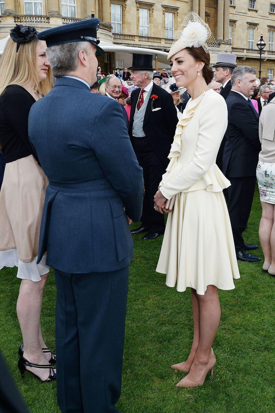 """<p>The Duchess dressed in all-white Alexander McQueen at a garden party at Buckingham Palace. It's the <a href=""""https://www.harpersbazaar.com/celebrity/latest/news/a1130/while-you-were-sleeping-102313/"""" rel=""""nofollow noopener"""" target=""""_blank"""" data-ylk=""""slk:same ensemble"""" class=""""link rapid-noclick-resp"""">same ensemble</a> she wore for Prince George's christening in 2013—cream-colored separates, hat and all.</p>"""
