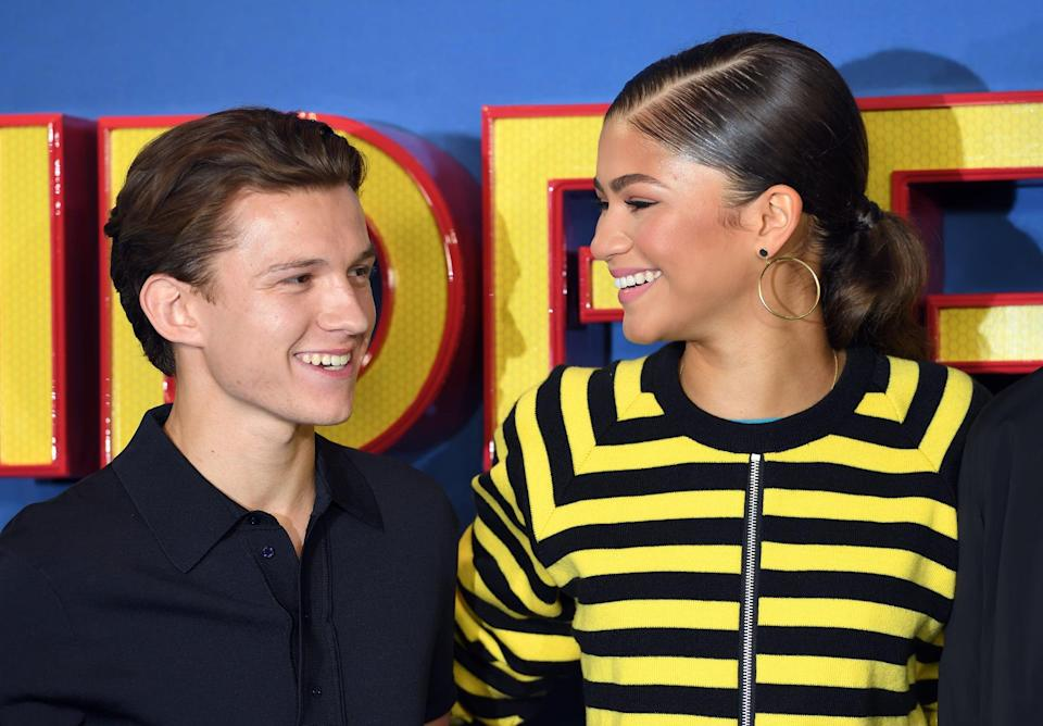 """<p>Unlike their Spider-Man couple forbearers, it took years for <a href=""""http://www.popsugar.com/Zendaya"""" class=""""link rapid-noclick-resp"""" rel=""""nofollow noopener"""" target=""""_blank"""" data-ylk=""""slk:Zendaya"""">Zendaya</a> and <a href=""""http://www.popsugar.com/Tom-Holland"""" class=""""link rapid-noclick-resp"""" rel=""""nofollow noopener"""" target=""""_blank"""" data-ylk=""""slk:Tom's"""">Tom's</a> relationship to develop past the point of friendship. Romance rumors began circulating as early as 2017 thanks to their respective performances as Michelle """"MJ"""" Jones and Peter Parker in <strong>Spider-Man: Homecoming</strong>, but both have insisted they're just friends. Since then, we've watched the two star in <a href=""""http://www.popsugar.com/entertainment/photo-gallery/44939588/video/44939650/Tom-Holland-Umbrella"""" class=""""link rapid-noclick-resp"""" rel=""""nofollow noopener"""" target=""""_blank"""" data-ylk=""""slk:one of the best Lip Sync Battles of all time"""">one of the best Lip Sync Battles of all time</a>, film the sequel <strong>Spider-Man: Far From Home</strong>, <a href=""""https://www.popsugar.com/celebrity/zendaya-and-tom-holland-relationship-timeline-48412133"""" class=""""link rapid-noclick-resp"""" rel=""""nofollow noopener"""" target=""""_blank"""" data-ylk=""""slk:and even date other people"""">and even date other people</a>! </p><p><br></p> <p>Both have always been supportive of each other's careers with Tom telling <strong>British GQ</strong> that he credits <a class=""""link rapid-noclick-resp"""" href=""""https://www.popsugar.com/Zendaya"""" rel=""""nofollow noopener"""" target=""""_blank"""" data-ylk=""""slk:Zendaya"""">Zendaya</a> with helping him <a href=""""http://www.gq-magazine.co.uk/culture/article/tom-holland-cherry-interview"""" class=""""link rapid-noclick-resp"""" rel=""""nofollow noopener"""" target=""""_blank"""" data-ylk=""""slk:adjust to celebrity life"""">adjust to celebrity life</a> and that he is """"so proud of what she has accomplished with <strong><a class=""""link rapid-noclick-resp"""" href=""""https://www.popsugar.com/latest/Euphoria"""" rel=""""nofollow noopener"""" target=""""_blank"""" data-"""