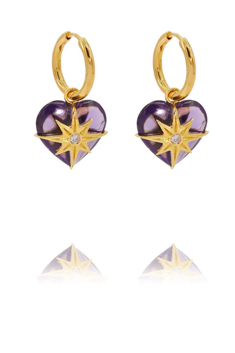 """<p><a class=""""link rapid-noclick-resp"""" href=""""https://theodorawarre.co.uk/amethyst-amethyst-heart-earrings"""" rel=""""nofollow noopener"""" target=""""_blank"""" data-ylk=""""slk:SHOP NOW"""">SHOP NOW</a></p><p>If pink isn't your thing, perhaps a pair of amethyst hearts inlaid with golden stars will strike the right note instead. </p><p>Gold-plated amethyst earrings, £360, <a href=""""https://theodorawarre.co.uk/"""" rel=""""nofollow noopener"""" target=""""_blank"""" data-ylk=""""slk:Theodora Warre"""" class=""""link rapid-noclick-resp"""">Theodora Warre</a>.</p>"""
