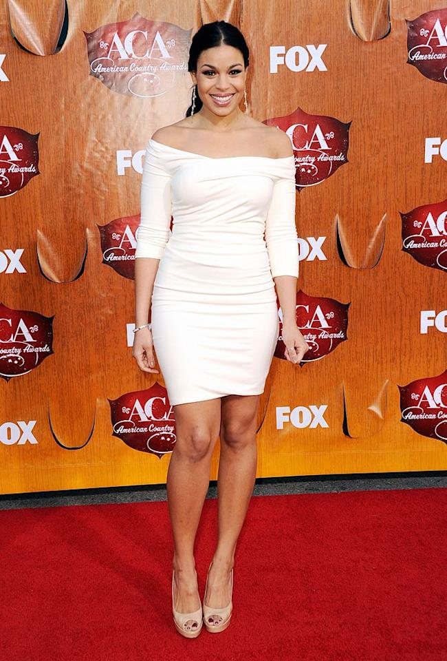 """""""American Idol"""" champ Jordin Sparks was a vision in white when she arrived at the MGM Grand Garden Arena in Las Vegas for the American Country Awards in this off-the-shoulder Kevan Hall number paired with peep-toe nude pumps. (12/05/2011)"""