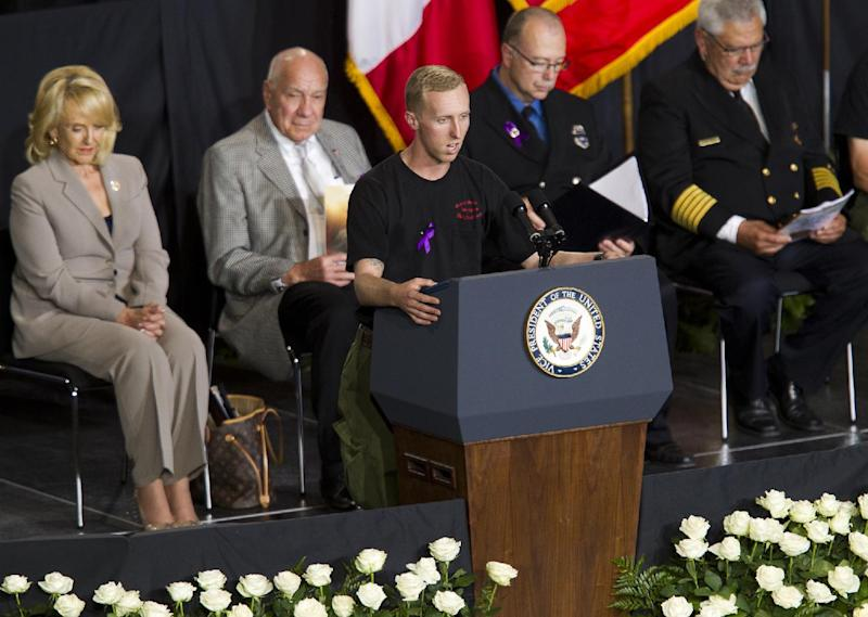 "Brendan McDonough recites The Hot Shot's Prayer during the ""Our Fallen Brothers"" memorial service for the 19 fallen firefighters at Tim's Toyota Center in Prescott Valley, Ariz. on Tuesday, July 9, 2013. Prescott's Granite Mountain Hotshots were overrun by smoke and fire while battling a blaze on a ridge in Yarnell, about 80 miles northwest of Phoenix on June 30, 2013. (AP Photo/The Arizona Republic, Michael Chow, Pool)"