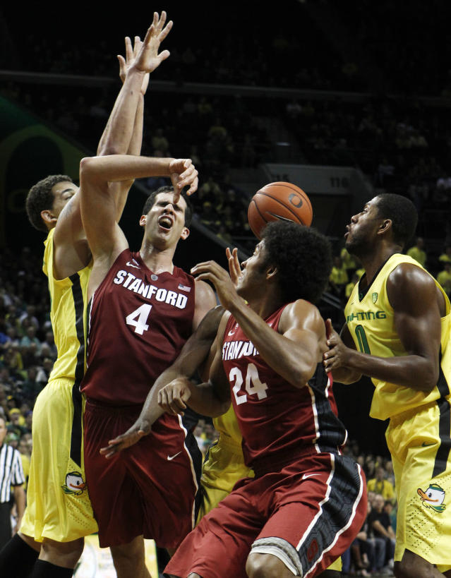 Oregon's Waverly Austin, left, knocks the ball loose from Stanford's Stefan Nastic as Stanford's Josh Huestis and Oregon's Mike Moser work inside during the play during the first half of an NCAA college basketball game in Eugene, Ore., Sunday, Jan. 12, 2014. (AP Photo/Chris Pietsch)