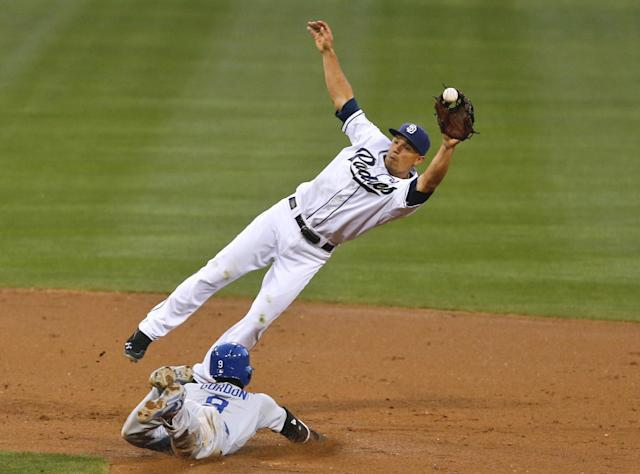 San Diego Padres second baseman Jace Peterson reaches for an errant throw as Los Angeles Dodgers' Dee Gordon steals second during the second inning of a baseball game Friday, June 20, 2014, in San Diego. (AP Photo/Lenny Ignelzi)