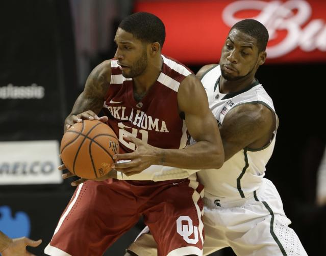 Michigan State's Branden Dawson, right, defends against Oklahoma's Cameron Clark (21) during the first half of the championship game in the Coaches vs. Cancer NCAA college basketball game on Saturday, Nov. 23, 2013, in New York. (AP Photo/Frank Franklin II)