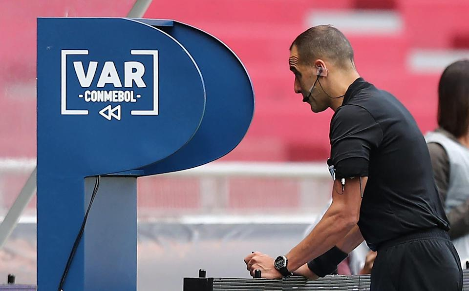 Uruguayan referee Esteban Ostojich checks the VAR during the South American qualification football match for the FIFA World Cup Qatar 2022 between Ecuador and Peru at the Rodrigo Paz Delgado Stadium in Quito - - GETTY IMAGES