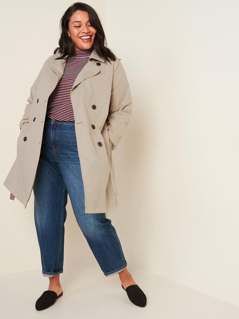 <p>The <span>Water-Resistant Tie-Belt Plus-Size Trench Coat </span> ($60, originally $63) is a classic piece you'll get tons of wear out of.</p>