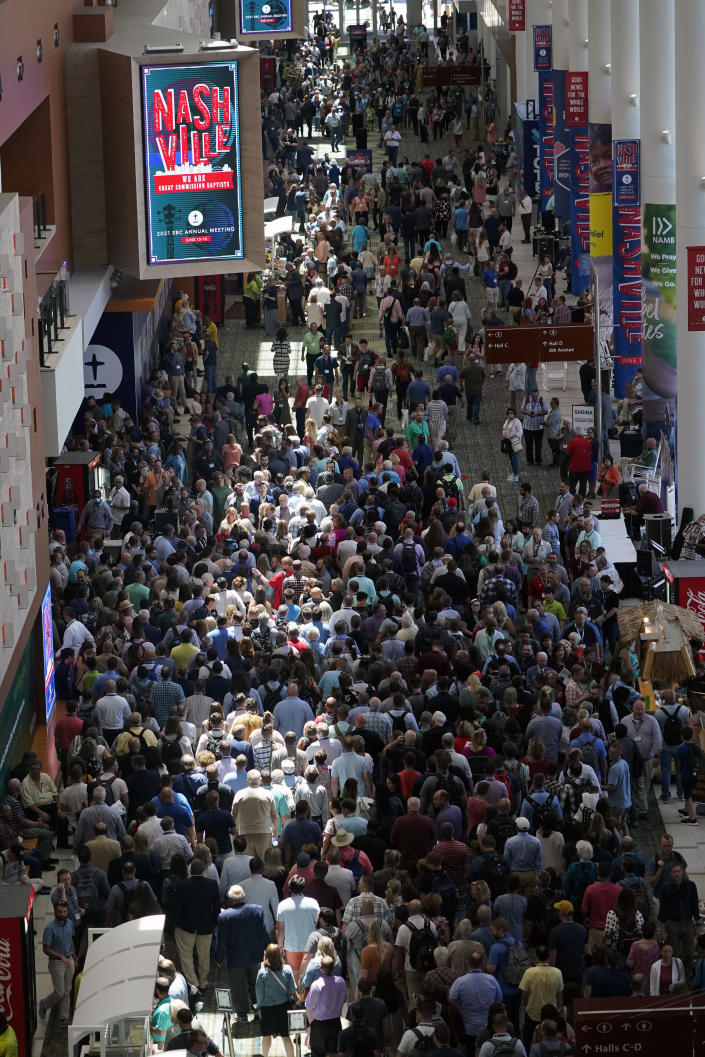 People make their way to a meeting hall for the afternoon session of the annual Southern Baptist Convention meeting Tuesday, June 15, 2021, in Nashville, Tenn. (AP Photo/Mark Humphrey)