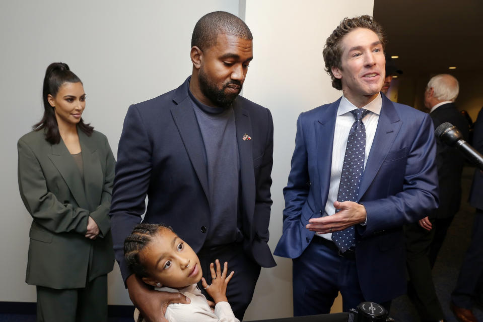 From left, Kim Kardashian West, North West, Kanye West and Joel Osteen answer questions after the 11 a.m. service at Lakewood Church, Sunday, Nov. 17, 2019, in Houston. (AP Photo/Michael Wyke)