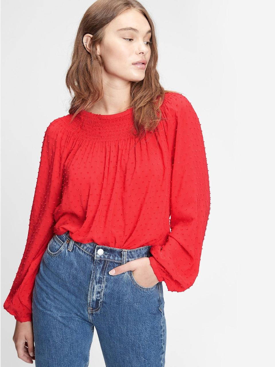 <p>We love the rich red of this <span>Gap Smocked Raglan Top</span> ($44, originally $60). Pair it with a pair of true blue jeans!</p>