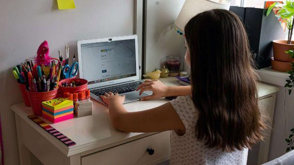 PHOTO: A kid sits in front of her computer as she does homeschooling at her home as the city continues Phase 4 of re-opening following restrictions imposed to slow the spread of coronavirus on Sept. 27, 2020 in New York City. (Noam Galai/Getty Images, FILE)