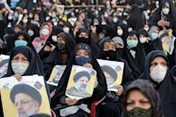 Raisi supporters attend a campaign rally in Eslamshahr, south of Tehran, on June 6