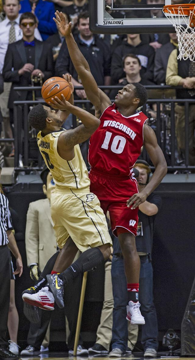 Wisconsin's Nigel Hayes (10) goes up to block the shot of Purdue's Terone Johnson (0) in the first half of an NCAA college basketball game, Saturday, Jan. 25, 2014, in West Lafayette, Ind. (AP Photo/Doug McSchooler)