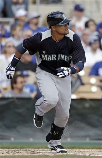 Seattle Mariners' Franklin Gutierrez watches his single off Los Angeles Dodgers starting pitcher Aaron Harang to drive in two runs in the second inning of a spring training baseball game Saturday, March 9, 2013, in Glendale, Ariz. (AP Photo/Mark Duncan)