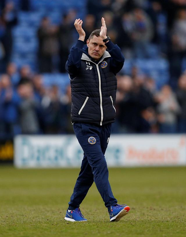 "Soccer Football - League One - Shrewsbury Town vs AFC Wimbledon - Montgomery Waters Meadow, Shrewsbury, Britain - March 24, 2018 Shrewsbury Town manager Paul Hurst applauds the fans after the match Action Images/Ed Sykes EDITORIAL USE ONLY. No use with unauthorized audio, video, data, fixture lists, club/league logos or ""live"" services. Online in-match use limited to 75 images, no video emulation. No use in betting, games or single club/league/player publications. Please contact your account representative for further details."