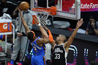 Oklahoma City Thunder guard Shai Gilgeous-Alexander (2) shoots as Los Angeles Clippers forward Nicolas Batum (33) defends during the first quarter of an NBA basketball game Friday, Jan. 22, 2021, in Los Angeles. (AP Photo/Ashley Landis)